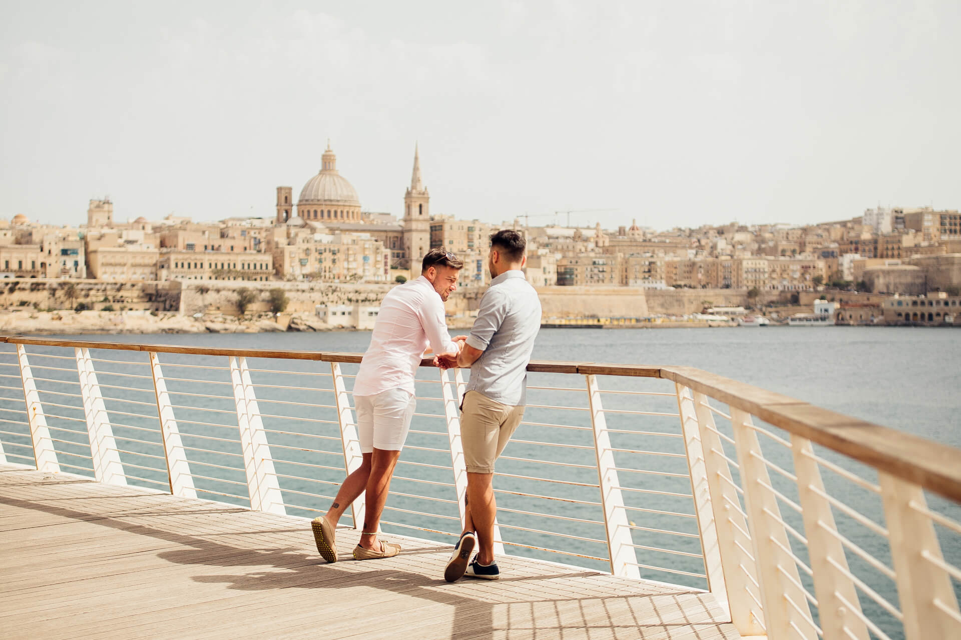 LGBT couple in Silema, looking over to Valletta