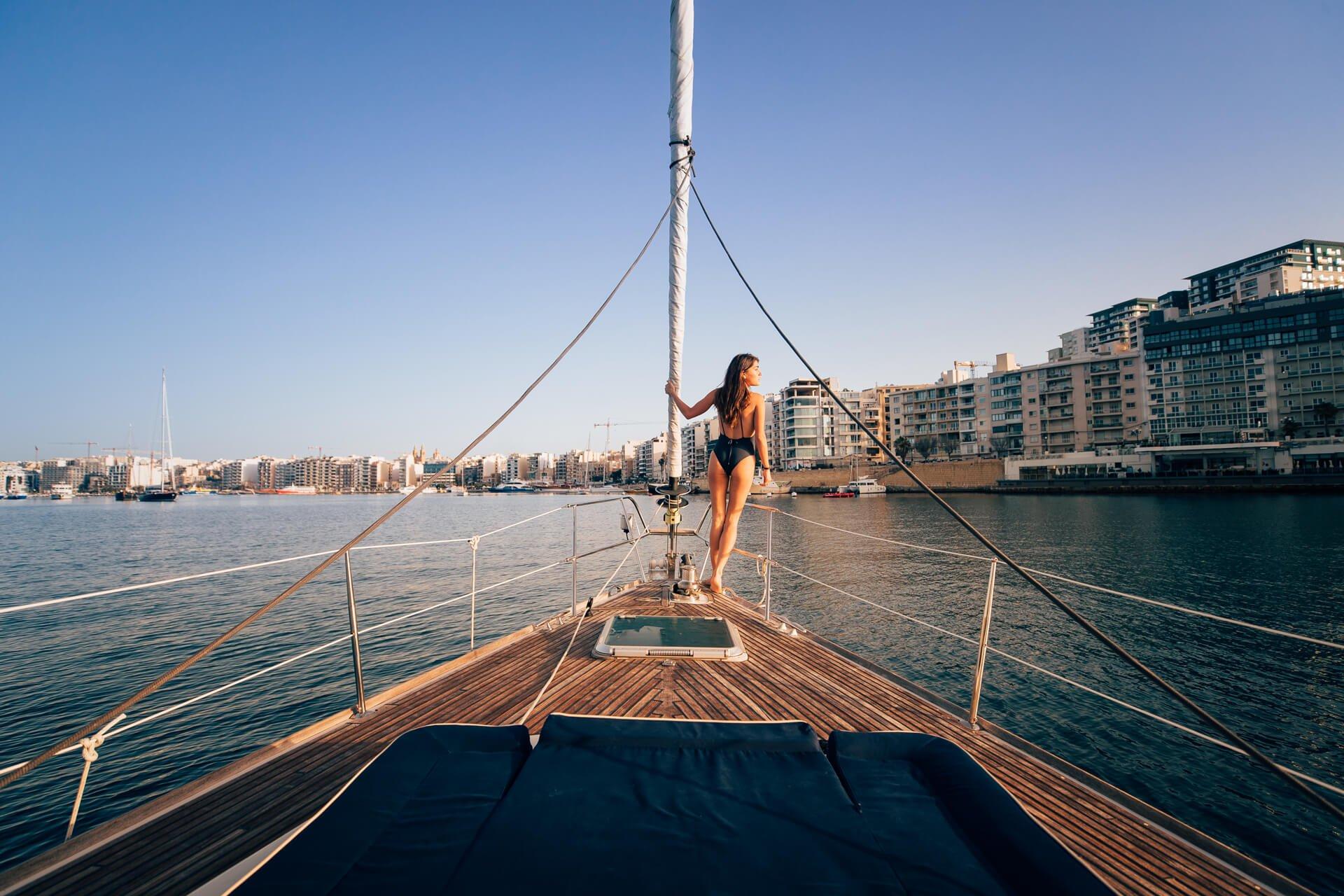 Model on yacht off Silema, Malta